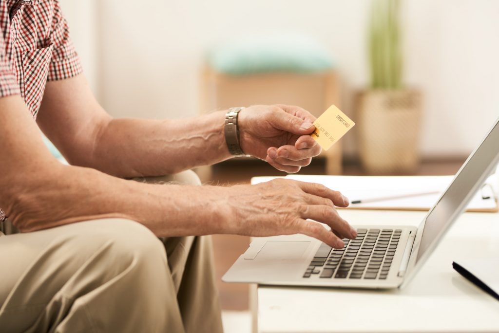 Senior Man Online Shopping from Home
